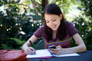Student-studying-on-mobile-device